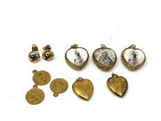 A small collection of heart shaped lockets, religious pendants,