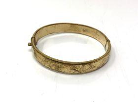 A rolled gold vintage bangle