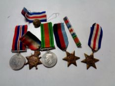 A group of First and Second World War medals including a 1914-15 Star awarded to R-10854 PTE T. A.