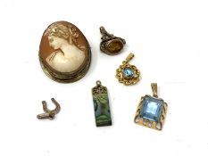 An antique cameo brooch together with pendants,
