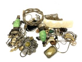 A quantity of costume jewellery, pendants, chains,