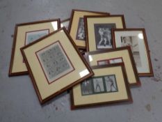 A group of approximately nine framed boxing prints