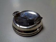 A silver ashtray