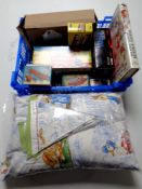 A crate containing boxed clockwork toys, a Beatrix Potter volume,