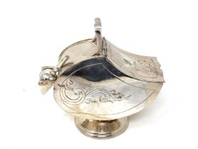 A silver plated sugar scuttle with scoop