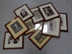 A group of approximately ten framed boxing prints