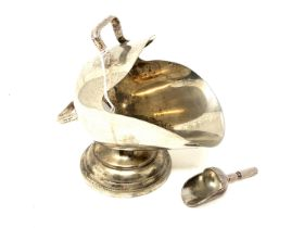 A silver plated sugar scuttle with shovel