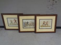 A set of three framed boxing prints