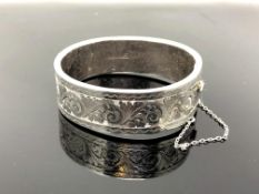 An engraved silver bangle CONDITION REPORT: 29.