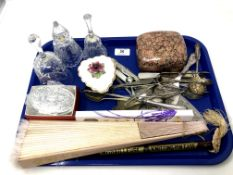 A tray containing hand fans, plated cutlery, glass bells, trinket box etc.