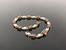 A 9ct gold gem set bracelet (broken). CONDITION REPORT: 10.