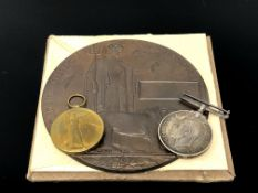 A First World War medal pair and death plaque, awarded to 175405 Gnr. R. W. Cowen R.A.