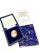 A limited edition 18ct gold mounted cameo brooch by Goldsmiths, number 168 of 200,
