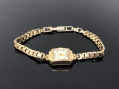 A lady's 9ct gold Helvetia wristwatch on 9ct gold strap. CONDITION REPORT: 11.