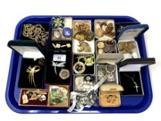 A tray containing antique and later costume jewellery, silver crucifix pendant, silver locket etc.