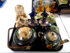 A tray containing miscellany to include German bisque figure of a baby eating chocolate,