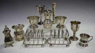 A collection of assorted 20th century silver items, comprising a pair of four-division toast
