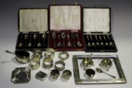 A collection of assorted silver items, including a pair of George V silver napkin rings,