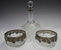 A pair of Continental silver mounted cut glass circular bowls, pierced with trailing vines, diameter
