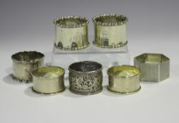 A pair of Edwardian silver napkin rings with beaded rims, Sheffield 1904 by Atkin Brothers, together