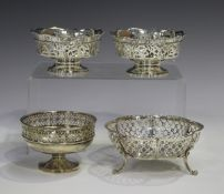 A pair of Edwardian silver bonbon baskets, each with pierced rim and sides, on a circular foot,