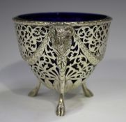 A George V silver sugar basket with pieced scrollwork decoration, the ovoid body with ram's mask and