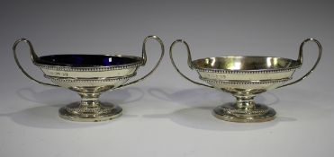 A pair of George IV silver oval two-handled salts with beaded bands, London 1828 by William Eley II,