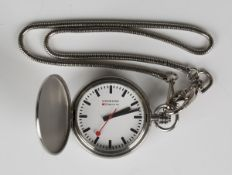 A Mondaine Watch Ltd steel hunting cased pocket watch, the signed white dial with black baton hour
