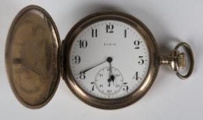 An Elgin gilt metal keyless wind hunting cased gentleman's pocket watch, the gilt lever movement