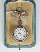 A pale blue enamelled, imitation pearl and red paste set keyless wind open-faced lady's fob watch