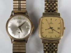 An Accurist 9ct gold circular cased gentleman's wristwatch, the signed silvered with baton hour