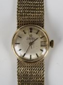 An Omega Automatic 9ct gold lady's bracelet wristwatch, the signed silvered dial with baton hour