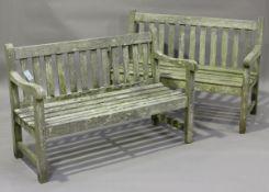 A near pair of 20th century slatted hardwood garden benches, height 84cm, width 122cm, depth 61cm.