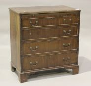 A 20th century George III style mahogany bachelor's chest, fitted with a brushing slide and four