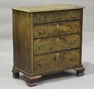 A 19th century and later mahogany chest of four graduated long drawers, on ogee bracket feet, height