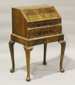 A 20th century Queen Anne style walnut lady's bureau with feather and crossbanded decoration, height