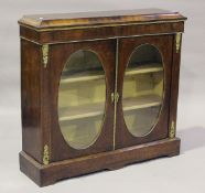 A late Victorian walnut side cabinet with gilt metal mounts, fitted with two oval glazed panel