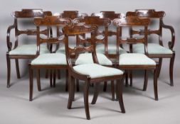 A set of eight Regency figured mahogany bar back dining chairs with carved scroll decoration and