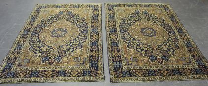 A pair of Hamadan rugs, early 20th century, the dark blue fields with scrolling terracotta