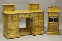 A late Victorian satinwood bedroom suite by M. Woodburn of Liverpool, comprising a wardrobe,