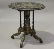 A late 19th century Middle Eastern hardwood and bone inlaid circular wine table, on turned spindle