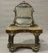 A late Victorian mahogany Duchess dressing table by Taylor, Fisher & Blunt, London, raised on carved