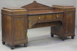 A William IV mahogany twin-pedestal sideboard with applied beaded and moulded decoration, fitted