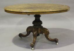 A late Victorian burr walnut oval tip-top breakfast table, raised on carved cabriole legs, height