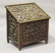 An early 20th century mahogany slope-front log box with carved foliate decoration, height 72cm,