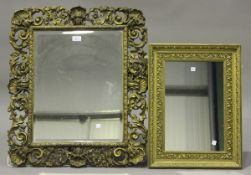A 20th century gilt painted rectangular wall mirror, the bevelled glass within a frame of shells and