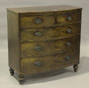 An early Victorian mahogany bowfront chest of drawers, on turned legs, height 105cm, width 106cm,