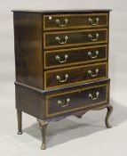An early 20th century George III style mahogany and satinwood crossbanded chest, raised on