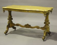 A mid-Victorian birds' eye maple and satin walnut centre table, the serpentine top above a pair of
