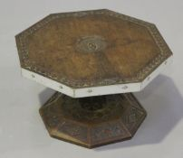 A late 19th century teak octagonal revolving table-top platter, the top carved with a crest and